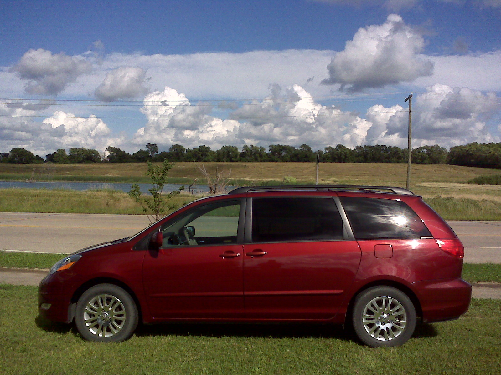 Photograph of a maroon 2007 V6, front-wheel-drive Toyota Sienna minivan